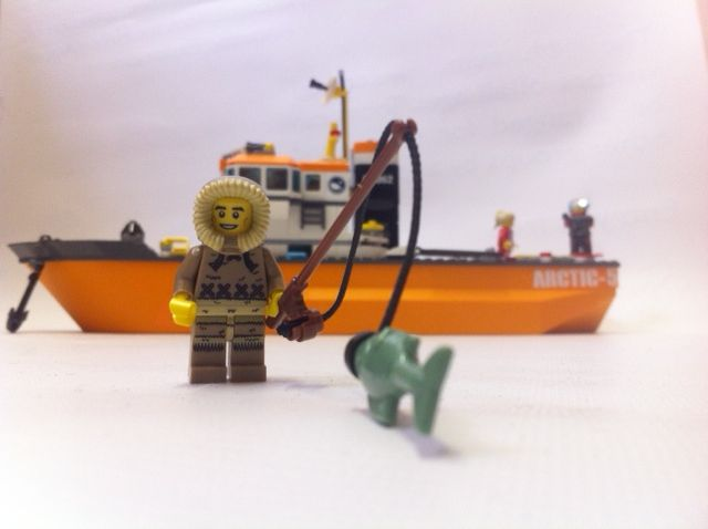 Toy boat and arctic figure