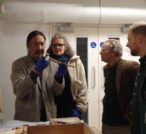 Art examining a pipe