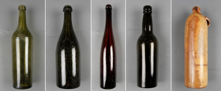 Y: 83/3/1-5. Five bottles collected from the base of the German International Polar Year Expedition 1882-83. Perhaps they were part of the pyramid of bottles left at the hut?