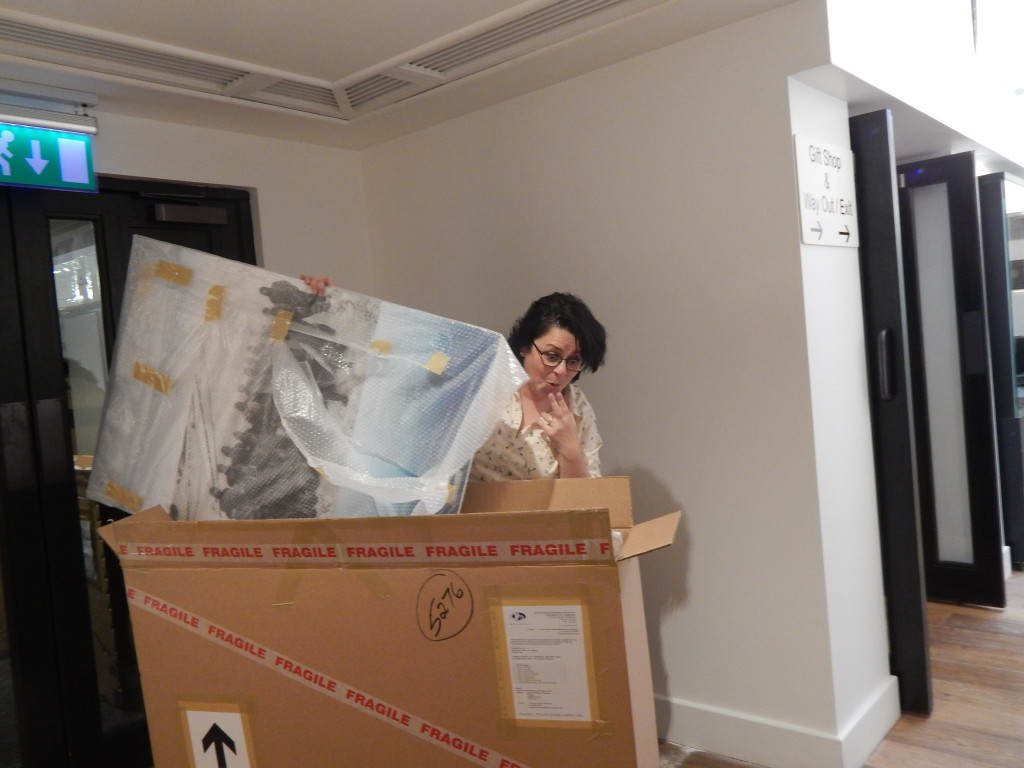 Falkland Islands Museum Manager Andrea Barlow takes a first peek at the newly arrived packages.